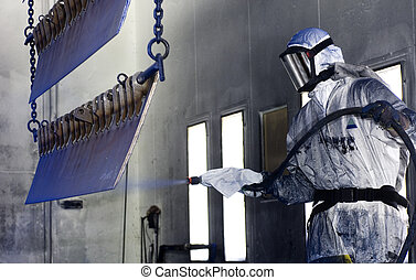 Spray painter - Man in a protective suit, wearing a gas mask...