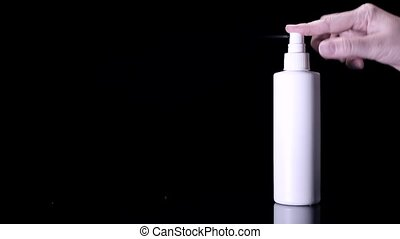Woman using a spray sanitizer as an alternative for hand ...