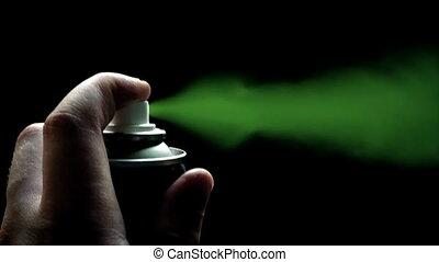 Spraycan Sprays Green Paint - Hand with spraycan sprays...