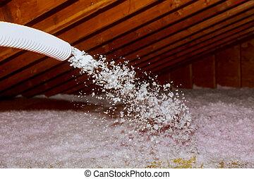 Spraying Blown Fiberglass Insulation for roof - technician...