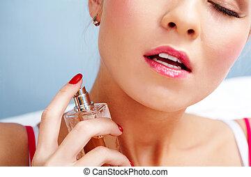 Spraying eau de toilette - Photo of sensual woman spraying...