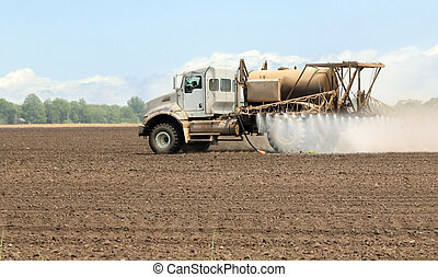 Spray truck spraying chemicals onto a farm field