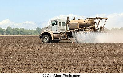 Spraying Farmland - Spray truck spraying chemicals onto a...