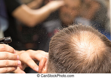 spraying with hair spray in beauty salon
