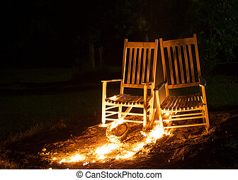 Spreading Fire - Rocking chairs on fire with the flames...