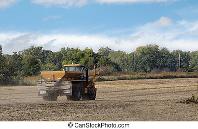 Spreading Lime - Spreading lime fertilizer onto a farm field