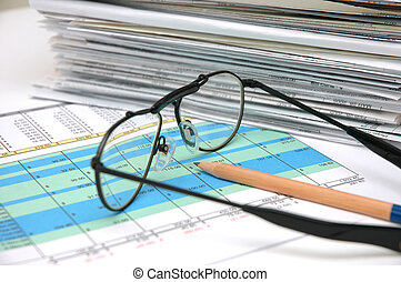 Spreadsheet 3 - Stack of bills and spreadsheet