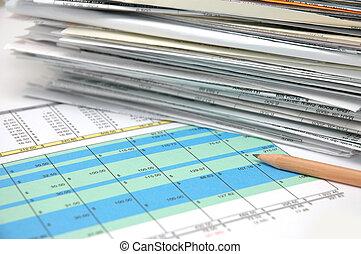 Spreadsheet 4 - Stack of bills and spreadsheet