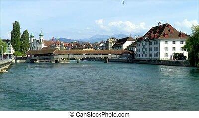 Spreuer Bridge over the Reuss River in Luzern, Lucerne, Switzerland. Jesuit Church in the background.