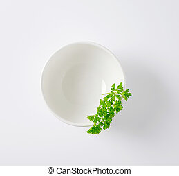 fresh parsley in white bowl