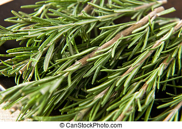Sprigs of fresh rosemary, an aromatic potherb used as a...