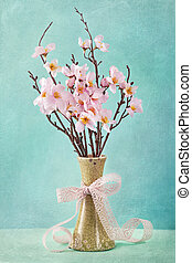 Spring apple blossoms in a white vase