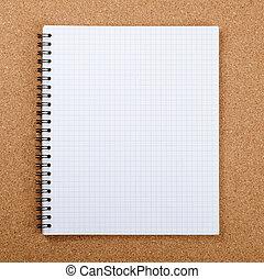 Spring at a notebook - The spring at a notebook on corkboard