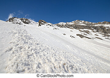 Spring avalanches in the Alps - Spring avalanche fans caused...