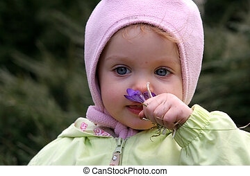 Spring baby  - Little baby smelling crocuses