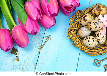 Spring background. A bouquet of tulips on a wooden background. Holiday greeting card for Valentine's Day, Woman's Day, Mother's Day, Easter