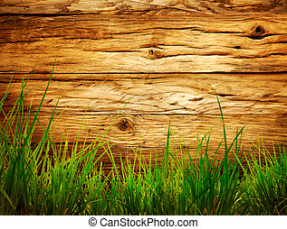 Spring background - Spring grass background. Grass over wood...