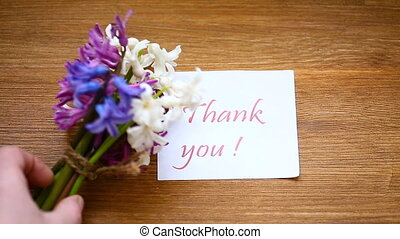 spring beautiful flowers of a hyacinth with a thank you card...