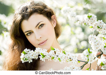 spring beauty - portrait of young woman in the garden, ...