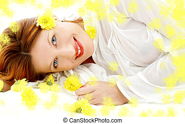 spring beauty with yellow flowers - portrait of lovely...