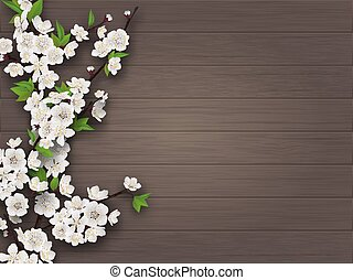 Spring blooming cherry branch on old wooden background.