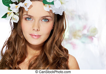 Portrait of a blue-eyed beauty with cute blush on her cheeks