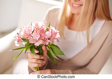 Spring bouquet - Close-up of smiling female holding bunch of...