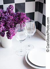 lilacs in a vase and glasses