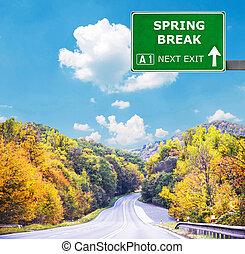 SPRING BREAK road sign against clear blue sky