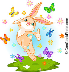 Cute little bunny jumping on the spring meadow