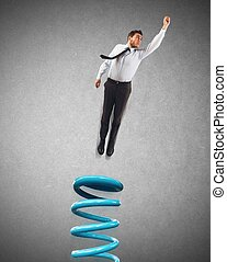Spring businessman - Businessman uses a spring to make leap