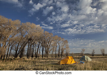 spring camping in Wyoming - two tents cover by frost in ...