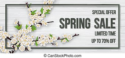 Spring card with blooming branch on wooden background.