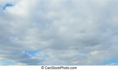 Spring clouds on a blue sky day. Time Lapse