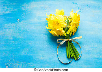 Spring concept with bright yellow daffodil flowers