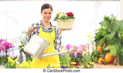 spring concept, woman florist - spring concept, smiling...