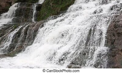 Spring Dzhurynskyi cascading waterfall - Close-up spring...