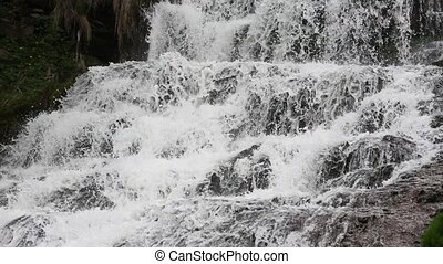 Spring Dzhurynskyi cascading waterfall