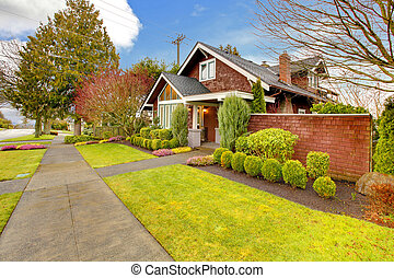 Spring exterior house with brown siding