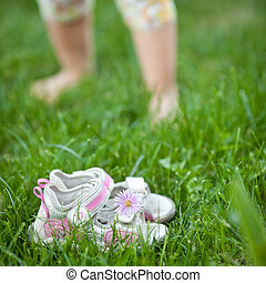 Spring feeling - Barefoot children's feet walking on spring...