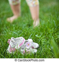 Spring feeling - Barefoot children's feet walking on spring ...