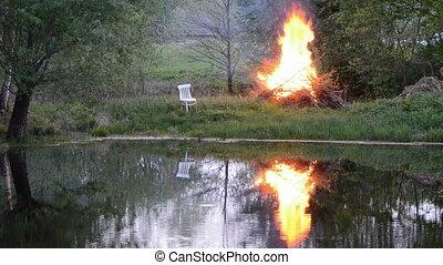 spring fire in farm near pond