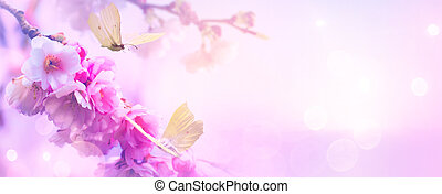 spring flowers and flying butterflies on the Sunrise sky background