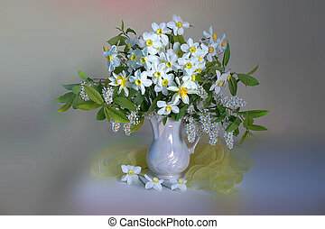 Spring flowers. Bouquet of yellow daffodils in a glass vase on a delicate background.