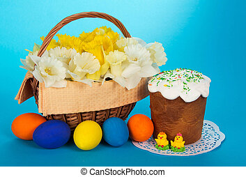 Easter cake and eggs - Spring flowers in a basket, an Easter...