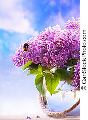flowers in a vase on sky background