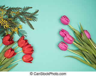 Spring flowers on a turquoise background. The view from the top.