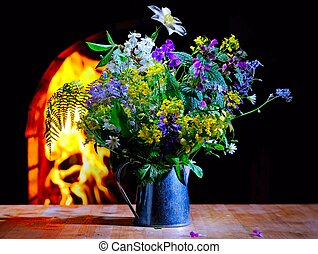Spring flowers on the fireplace background