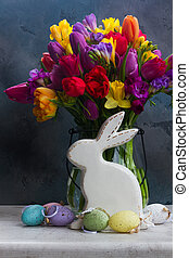 Spring flowers with easter rabbit and eggs