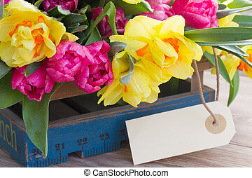 spring flowers with empty tag - spring tulips and daffodil...